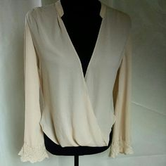 Jealous Tomato Sheer blouse Cream colored Jealous Tomato top with slight high low effect SZ xsmall  beautiful shirt for day or night jealous tomato Tops Blouses