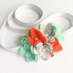 Hey, I found this really awesome Etsy listing at https://www.etsy.com/listing/286717045/felt-flower-headband-coral-and-mint