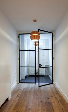 Flow Works , based in Amsterdam, overhauls homes and makes them functional and beautiful. I lov. Steel Frame Doors, Steel Doors And Windows, Door Design, House Design, Double Glass Doors, Pivot Doors, Front Rooms, House Doors, Glass House