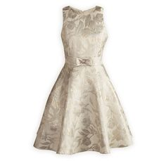 Glistening Gold and Silver Girls' Party Dress Classic girl's dress of metallic poly blend jacquard with princess seamed bodice and full swing skirt. Inset waistline has bow with rhinestone center accent. Hidden zip back closure. Fully lined. Knee length. Made in Canada exclusively for The Wooden Soldier.