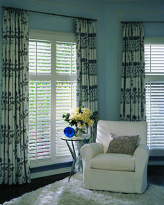 Drapes paired with #shutters give this room visual height and helps with sound absorption. This modern design really pops! #interiordesign #home @Hunter Douglas Window Fashions