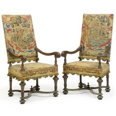 A pair of Louis XIV style carved walnut fauteuils, 19th century