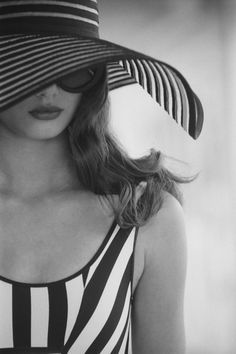 You will be at the beach this summer. You will want to make an impression. You'll need a big hat, the right, classic swim suit, and a great pair of sunglasses. Not a lot to worry about, but when it all comes together....it makes quite an impression.