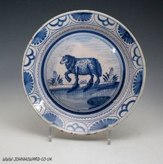 English blue and white delftware plate with image of a ewe in landscape c1725
