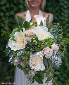 DIY Bridal Bouquet with Fresh and Crepe Paper Flowers. Step by step instruction on how to create your own bouquet for under $50 @LiaGriffith.com