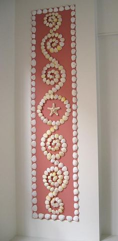 Lovely design on seashell panel; would make a pretty pattern for a garden mosaic.