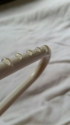Make a slip-free clothes hanger with hot glue. Put a few beadlets on the ends of your hanger and no more slip.
