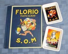 "Álbum de fotos ""Florio"" + 2 platitos Pottery Barn con afichitos de vermut Melchior y de marsala Florio S.O.M. / Pottery Barn vintage posters cocktail appetizer dishes 5"" x 3⅞"" set of 2 plates (vermouth Melchior & marsala Florio) plus 1 Photo album Florio 10"" high x 8¼"" wide x ¾"" deep"