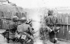 """A Leibstandarte Division MG 34 team in action in Ukraine during Operation Barbarossa, using a tripod """"Lafette 34"""" with telescopic sight for long-range firing."""