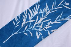 """cyanotype cotton fabric """"by the yard"""" (56"""", 90"""", 108"""" widths, white)  Holy Carp!  I can make throw pillows to match the wall art!"""
