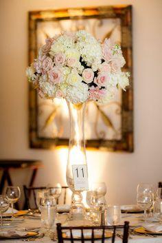 Tall centerpieces of roses, hydrangeas and dahlias