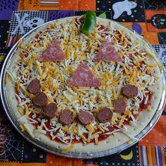 Jack-o-lantern pizza. Repinned from Vital Outburst clothing vitaloutburst.com