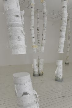 Tree Trunks with missing gaps inside gallery walls in the project 'Surtout ne prends pas froid' by Montreal-based artist Maude Léonard-Contant #art #installation #white