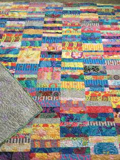 My take on the Missouri Star Broken Bars quilt using Kaffe Fassett fabrics. Quilted with echo blossom design.