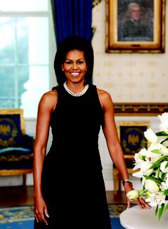 I love that she's smart, beautiful, TALL and feminine. She is me. *tall girls rock, smart girls rock* She always looks like she enjoys being a girl. She doesn't dress hard and she's not frilly. Just feminine and confident. I <3 FLOTUS.