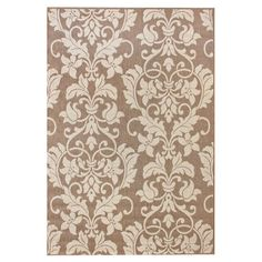 Anchor your patio seating or add a pop of pattern to your foyer with this versatile indoor/outdoor rug, showcasing a damask motif for a touch of elegant styl...