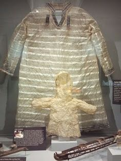 Adult and child-size kamleikas, made of seal intestine. Although these examples lack the drawstring needed to attach them to the cockpit coaming (suggesting that they were used ceremonially), Aleuts would wear waterproof garments like these when kayaking. From the Peabody Museum at Harvard University.
