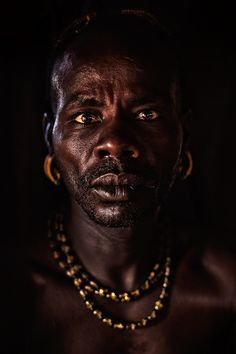 People of Omo Valley in Southern Ethiopia   by Mitchell Kanashkevich