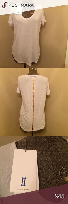 Kit Ace Cashmere blend V Tee Cashmere blend V Tee by Kit Ace size 10 NWT soft grey.  If you love lululemon you'll love Kit Ace, Canadian apparel brand; founded by former lead designer of lululemon, Shannon Wilson and her stepson. Kit Ace Tops Tees - Short Sleeve