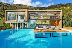 The spa house is a stunning modern rental in the secluded Hout Bay, offering breathtaking views of the Cape...
