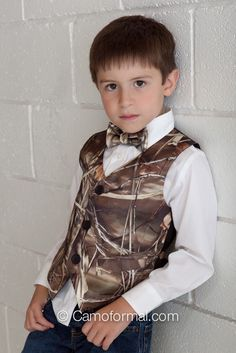 This set of both boy's vest and pre-tied long tie are all that you need to dress him to the formal or wedding. The vest and tie will look just right with either dress pants or jeans and boots. Available in trade-marked camo prints. Wedding Vest, Wedding Party Dresses, Wedding Attire, Camo Tuxedo, Tuxedo Vest, Vest And Bow Tie, Formal Vest, Camouflage Wedding, Dream Wedding