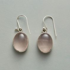ROSY WINDOW EARRINGS - Open-backed sterling silver bezels on these earrings lend natural illumination to smooth, domed ovals of pale pink rose quartz. French wires. Handcrafted Sundance exclusive.