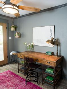 This space serves a dual purpose as a home office and a mudroom The newly partitioned space, which was originally part of the living room, includes new French doors with access to the backyard.