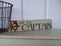Ask The CAPTAIN sign