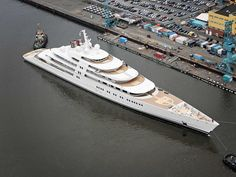The World's Largest Yacht designed by Nauta Yachts costs a total of $605 million (£372 million). This amazing yacht built by Lurssen it's staggering 590 ft long.
