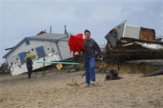 A man walks past cottages along Roy Carpenter's Beach that were destroyed by Hurricane Sandy in Matunuck, Rhode Island October Hurricane Sandy, Walk Past, Going On A Trip, Rhode Island, East Coast, New England, New York City, United States, Cottages
