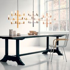 Manola is a magnificent and elegant chandelier from Herstal, consisting of a lacquered metal frame with 12 arms holding as many light sources. Dining Toom Decor, Dining Room Colors, Dining Room Design, Rustic Table, A Table, Elegant Chandeliers, Square Dining Tables, Dining Room Lighting, Modern Spaces