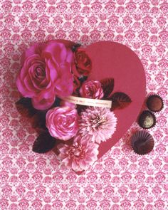 Embellish a chocolate box with silk flowers.