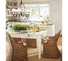 love the farmhouse table and chairs and the white furniture and natural light