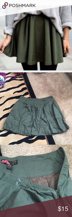 F21 olive green skater skirt size M 100% cotton. Belt loops and pockets on front. Side zip. Cover photo is close match to show how skirt can look when styled. 15 inches long. Waist 14.5 inches across. Small white mark see pic 3 Forever 21 Skirts Circle & Skater