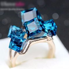 Blue Topaz Ring. Clearance deal is OVER.  The sparkling stones evoke images of the wind, sky, and water.Blue is the color of calm and quiet.It can help us channel relaxing energies and fight off chaos and negative emotions.Traditionally, the icy blue shades of topaz gemstones are associated with learning, understanding, creative inspiration and peaceful communication.In the past, topaz has been used to soothe fears and protect against nightmares to give a...