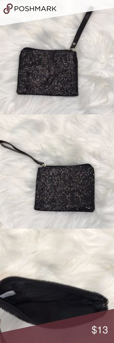 Black sparkle wristlet Black sparkle wristlet.  Great staple piece for your wardrobe and accessories.  Minor wear near zipper area displayed in picture 4.  *Descriptions are described to best ability but please do not hesitate to ask questions if more information is needed. Colors may vary slightly to lighting and photos.*   No modeling, no trades. Bags Clutches & Wristlets