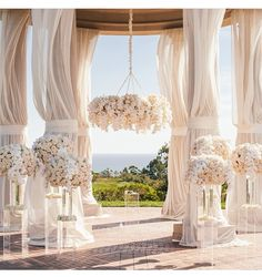 Chandelier made of flowers and beautiful orchids. A gazebo covered in light rose and white. A dreamy perfection! This is what dreams are made of!