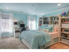 This Tiffany Blue bedroom is so beautiful. With its large bed with attached storage, work space, and huge closet you would never need to leave. Harrison, NY Coldwell Banker Residential Brokerage $2,249,500