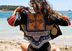 Spectacular genuine leather jacket customized with authentic vintage tribal textiles and tribal jewelry unique and exclusive. A timeless and unique