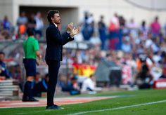 Luis Enrique manager of Barcelona applauds during the La Liga match between Club Atletico de Madrid and FC Barcelona at Vicente Calderon Stadium on May 17, 2015 in Madrid, Spain