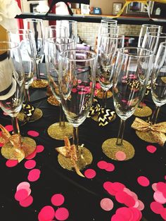 Kate Spade Themed bridal shower. Black, gold, pink, and white color theme.   Glam up champagne flutes purchased from the dollars tree using adhesive spray and glitter.