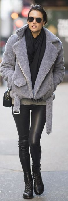 Who made  Alessandra Ambrosio's black handbag, ankle boots, leather pants, and gray teddy moto jacket?