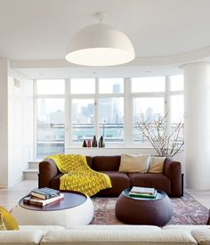 Mex sofas by Cassina and Fat Fat-Lady Fat tables from BB Italia are grouped in the living room.