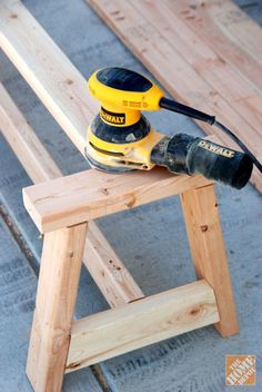 Sanding the edges of the farmhouse bench DIY project