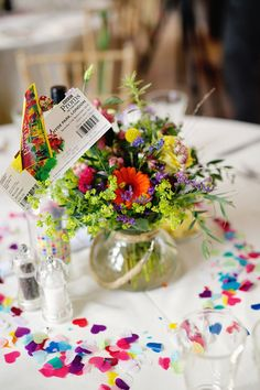 Jar vase flowers wedding table centerpiece with heart confetti for fresh fun rainbow garden wedding reception table decorations http://www.lydiastampsphotography.com/