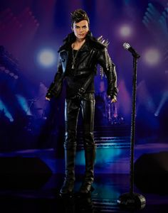 Inspired by Adam's performance with Queen at London's Hammersmith Apollo, Mattel designer Carlyle Nuera meticulously recreated every detail of Adam's concert look, right down to the spiked epaulettes on his leather jacket! Yes, Adam doll is wearing a real leather jacket; leather-look pants, gloves and boots are all rock-star worthy! His mic is fully embellished with Swarovski crystals.