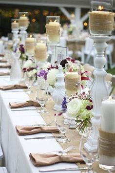 Wedding Shower Inspiration - Burlap and white candelsticks with purple flowers. Maybe we could spray paint old candlesticks to match and use orange/peach flowers?
