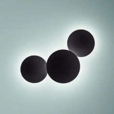 PUCK WALL ART is a modular collection designed by Jordi Vilardell. It's made up of unique compositions of sphere-shaped wall lamps in two sizes – producing an attractive ambient lighting effect free of shadows or reflections.