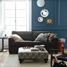 Inspiration for recovering the ottoman I just got for a steal but is now in ugly vinyl :)