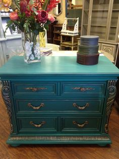 Florence Chalk Paint® with a wash of Graphite, Clear Wax, and German Silver Gilder's Paste. All sold and custom painted at TLC Design Studio!